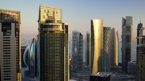 Panning across the new skyline of the West Bay central financial district of Doha, at sunset, Doha. Qatar, Middle East