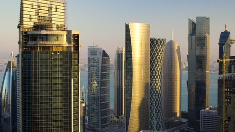 Zooming out from new skyline of the West Bay central financial district of Doha, at sunset, Doha. Qatar, Middle East