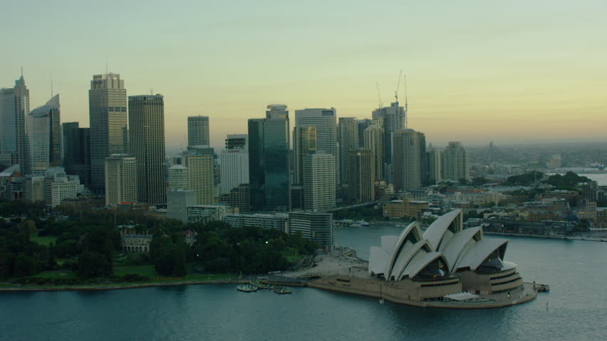 Sydney Australia - 2016: Aerial sunset dusk Opera House Skyscrapers Harbor Harbour sea Circular Quay Building city outdoor travel tourism business structure Finance Bay boat commuters RED DRAGON | Shutterstock HD Video #18805607