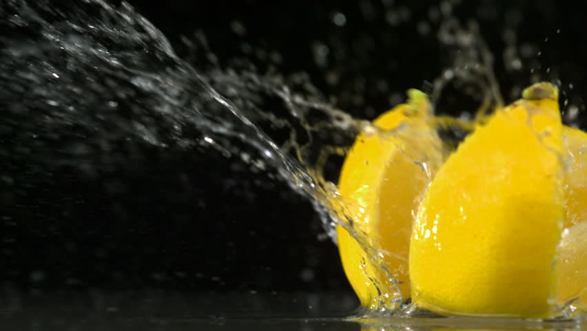 Slo-motion lemon  falling into wedges against black drop #1881007