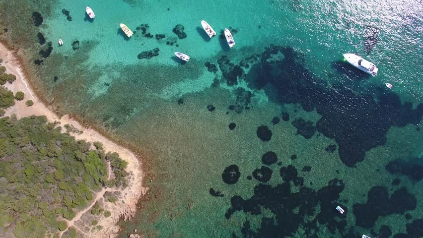 AERIAL DRONE: flying over beautiful bay, with boats and yachts in Sardegna Capo Coda Cavallo