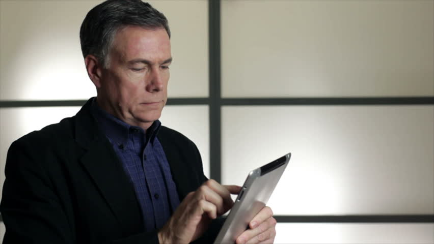 A businessman using an electronic tablet to research something. | Shutterstock HD Video #1882186
