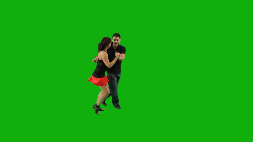 A couple dancing salsa against greenscreen