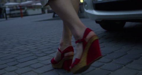 Sexy legs red high heels walking in city urban street - RED EPIC DRAGON 6K