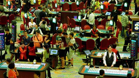 CHINA, MACAU - OCTOBER 2015: Sic Bo Poker & Black Jack Tables; Venentian Casino Macau China