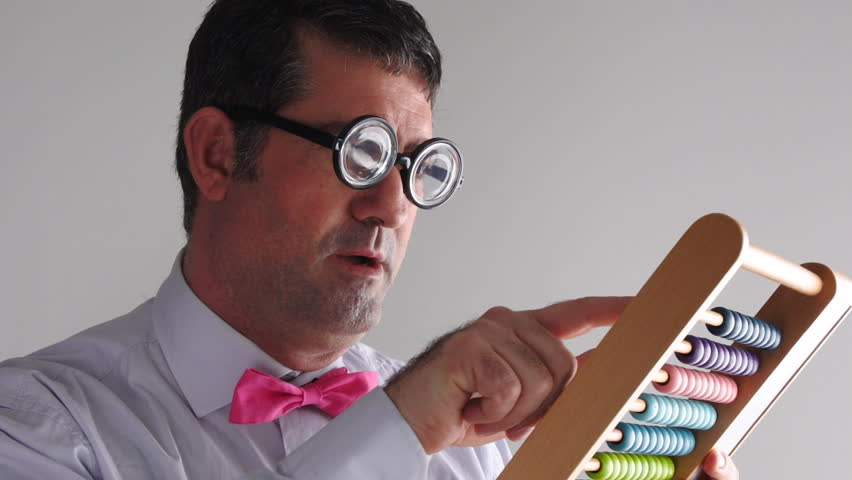 Geeky man accountant calculating with wooden numerator abacus. Finance, banking and economy concept. copy space