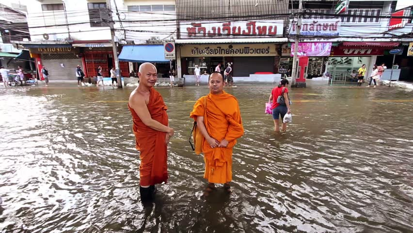 BANGKOK - 30 OCTOBER 2011: Two Buddhist monks in flood