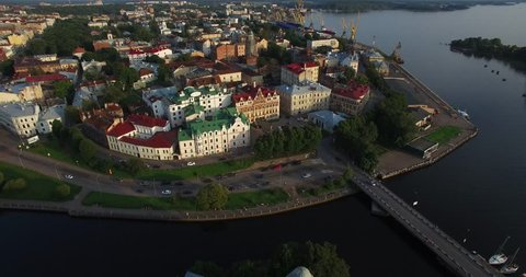 Aerial view drone footage of Vyborg town, water channels around old town center and Vyborg fortress in Russia