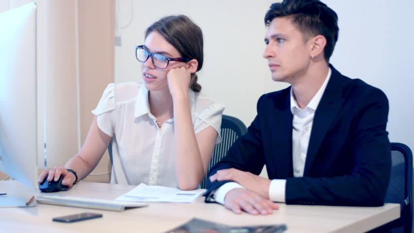 Work process of business woman and teammate businessman | Shutterstock HD Video #19070236