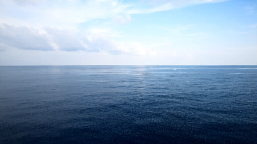 peaceful and calm shot of a gently lapping sea and nice sky with cloud?view from open deck of a cruise ship. - HD stock video clip