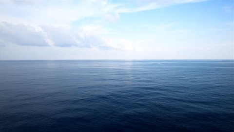 peaceful and calm shot of a gently lapping sea and nice sky with cloud, view from open deck of a cruise ship.