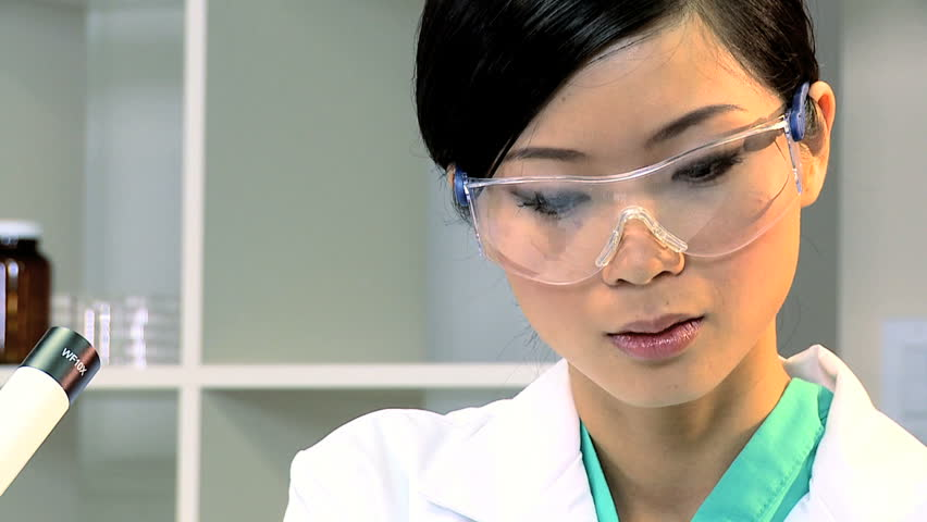 Female student doctor working with a microscope and test tubes in laboratory-full face | Shutterstock HD Video #1910536