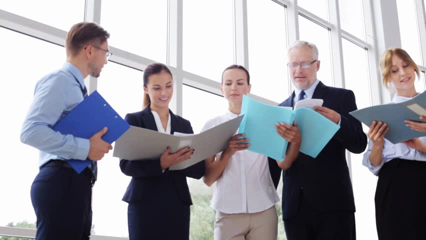 People, work and corporate concept - business team with folders meeting and talking at office building | Shutterstock HD Video #19126774