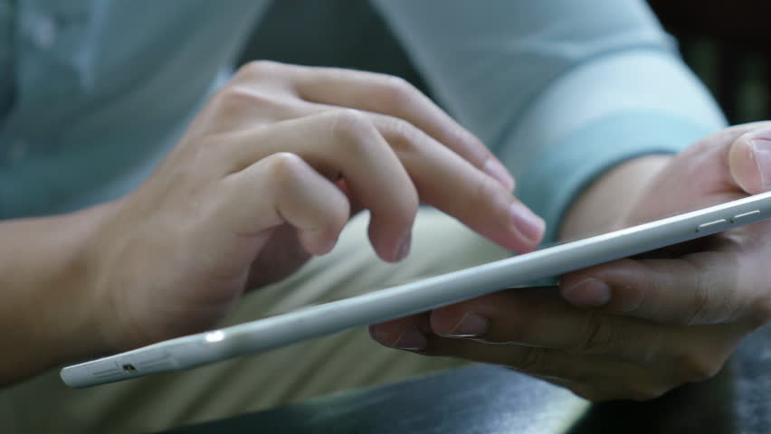 4K : Asian young man sitting on a sofa and using tablet pc | Shutterstock HD Video #19153174
