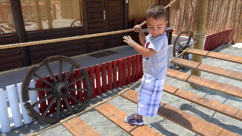 4K Two years old child learns balance on rope ladder  | Shutterstock HD Video #19153306