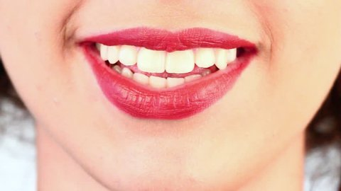 close-up of a woman's mouth that speaks quickly
