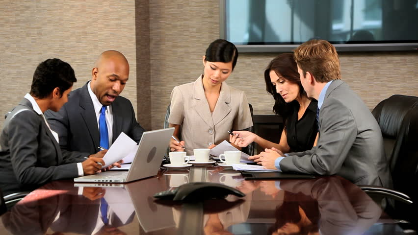 Five multi ethnic male and female business team members in conference in a modern office building | Shutterstock HD Video #1918276
