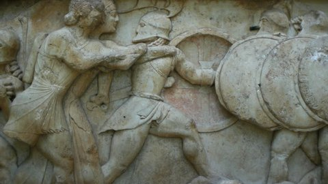 Ancient greek stone frieze representing the Gigantomachy battle