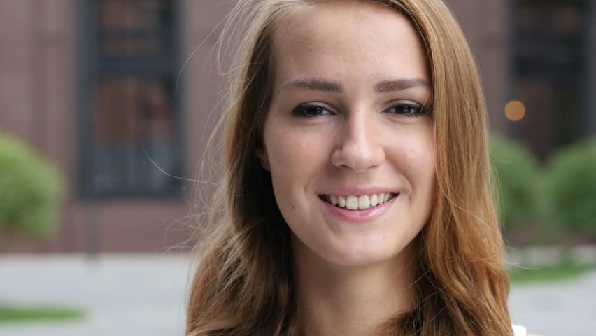 Smiling Beautiful young Girl, Outdoor   Shutterstock HD Video #19227292