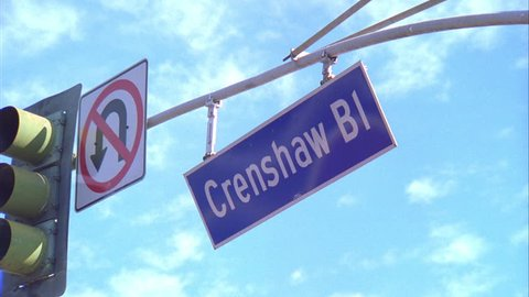 day Steep up angle, street sign Crenshaw Bl. traffic signal left, red, No U Turn sign Los Angeles
