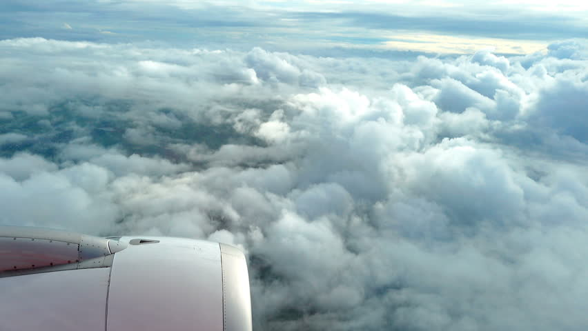 View through airplane window. Beautiful clouds with earth impressive #19248106