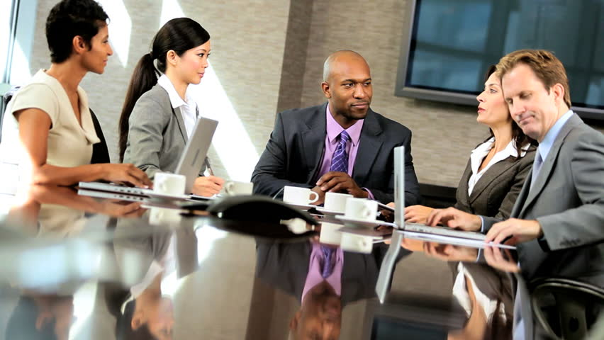 Male african american executive with his multi ethnic business team in the boardroom | Shutterstock HD Video #1925476