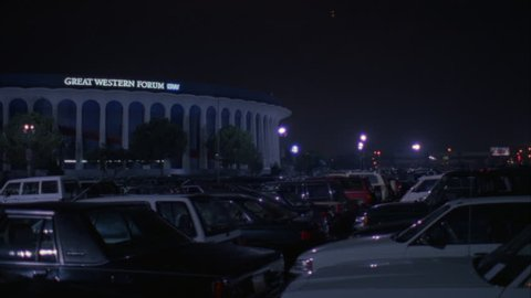 night across full parking lot pan left along Great Western Forum LA forum, indoor arena House Lakers basketball team from 1967 1999 , concert venue font color red Needs additional clearance font