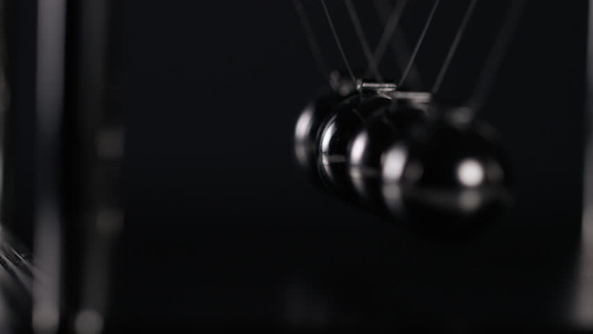 4K Abstract angle of Newton's cradle spheres, in slow motion