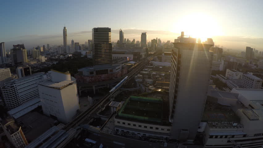 Aerial Bangkok, Thailand with train downtown sunset