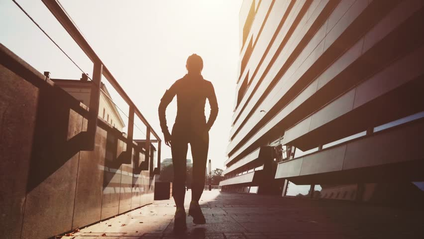 Runner Woman Running in the Sunny Modern Morning City. Steadicam STABILIZED shot, SLOW MOTION 120 fps. Athletic Fitness Sportswoman Listening to Music during Training. Healthy Lifestyle. Lens Flare. | Shutterstock HD Video #19367971
