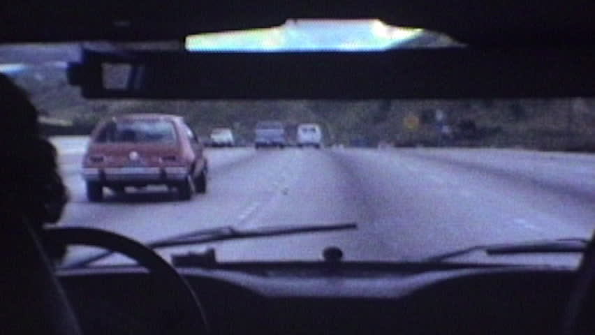 Thousand Oaks, California, USA - October 1, 1982::  Editorial vintage super 8 time lapse driving shot in the 101 Ventura Freeway through Calabasas near Los Angeles, California.
