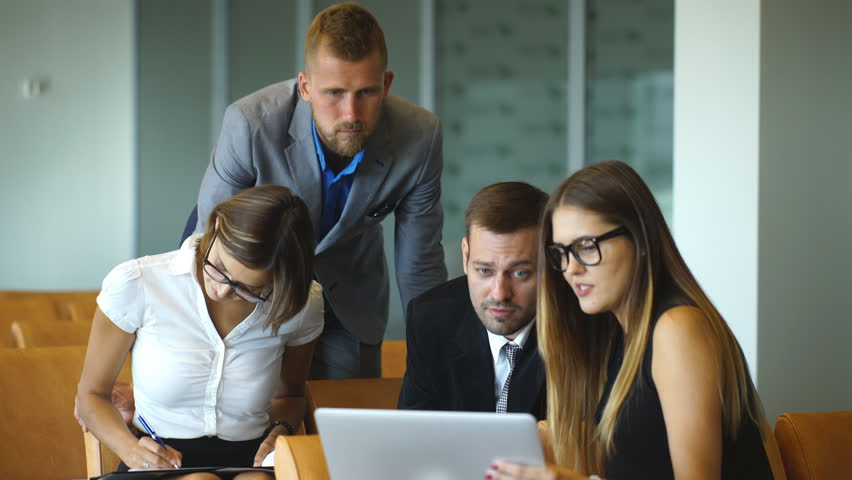 Businesspeople With Digital Tablet Having Meeting In Office #19451896