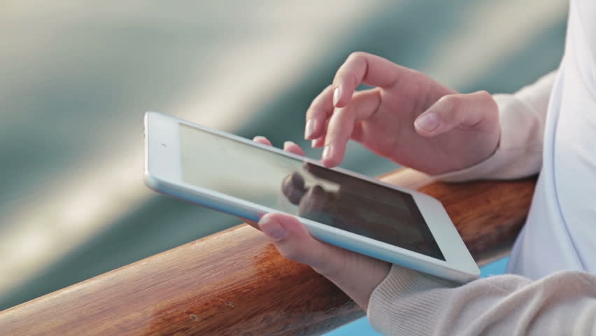 Man Is Shopping Online With Cell Phone Stock Footage Video - Using a cellphone on a cruise ship