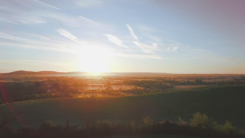 Aerial flight as sunrises over Somerset.