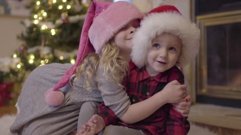 Cute Little Girl Gives Her Younger Brother A Huge Hug On Christmas
