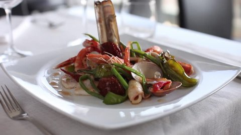 Prawn with vegetables and clams. 360 rotation food