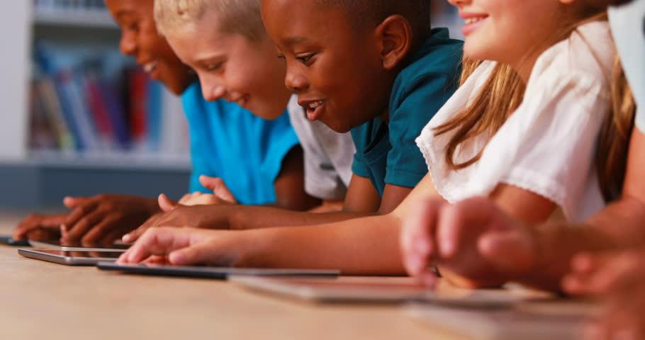School Kids Using Digital Tablet Stockvideos Filmmaterial 100