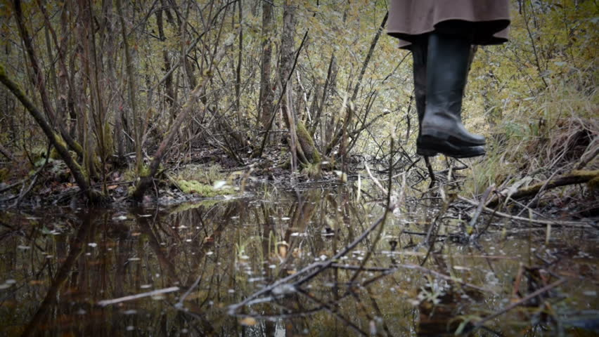 feet of hanged man over the rotten swamp, horizontal camera movement
