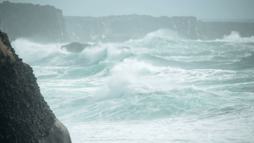 Seabirds coasting wind heavy ocean waves crashing rocky coast Iceland | Shutterstock HD Video #19563166