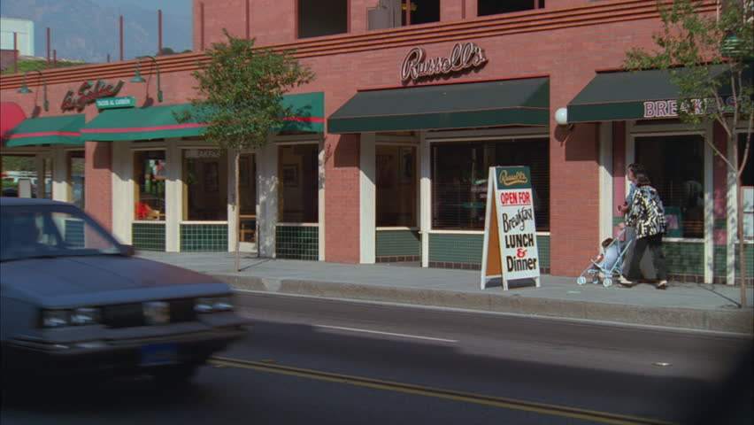 Day Pan right Russell's red brick bottom floor diner restaurant, green tile awning | Shutterstock HD Video #19600456
