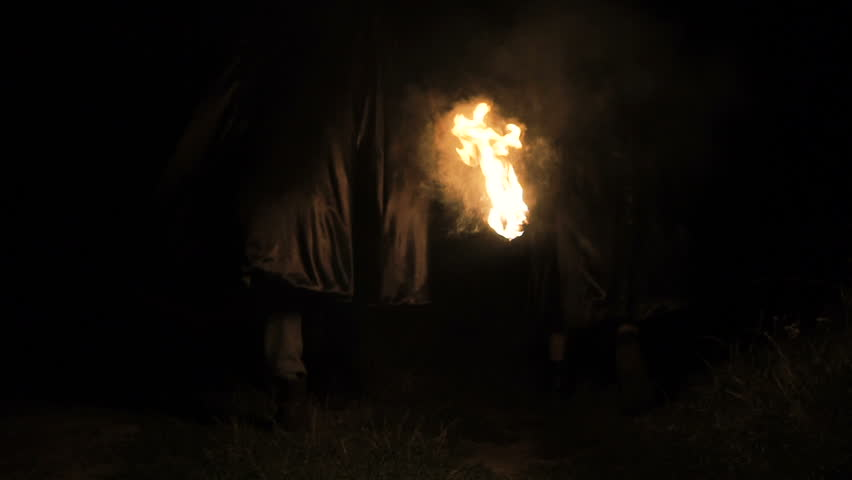 People in black coats with fire in hands going in dark forest. Slowly | Shutterstock HD Video #19612996