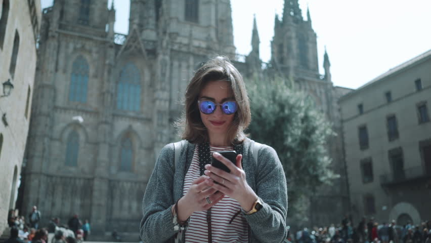 Young hipster traveler girl walking in the city and take picture via smartphone outside, attractive woman traveling at Europe looking landmarks in Barcelona, slow motion | Shutterstock HD Video #19637416
