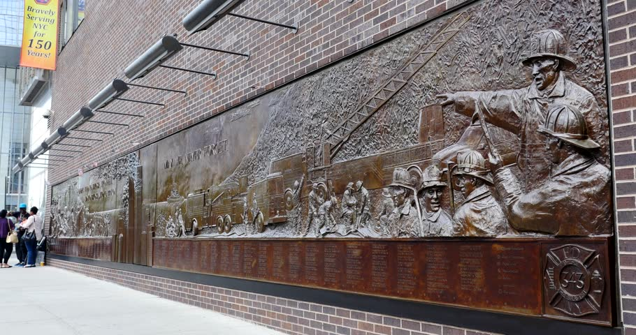 NEW YORK CITY - MAY 12, 2015: The Memorial Wall, located at FDNY Engine 10 Ladder 10, directly across from the World Trade Center site. It's dedicated to the 343 members of the NYFD who died on 9/11.