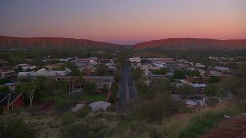 Sunrise over Alice Springs from the Anzac Hill lookout. This clip shows the sunlight start at the top of the hills and go all the way down.