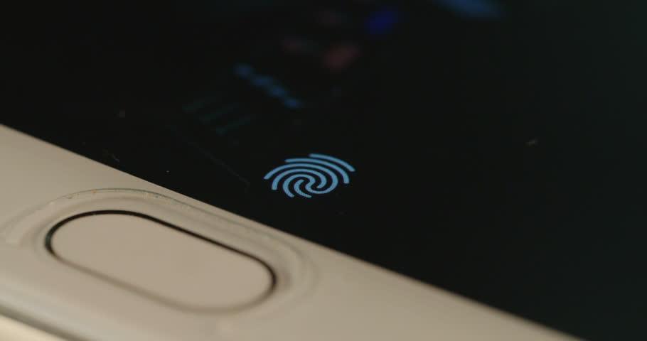 Fingerprint security screen unlocking on a smartphone   Shutterstock HD Video #19664047