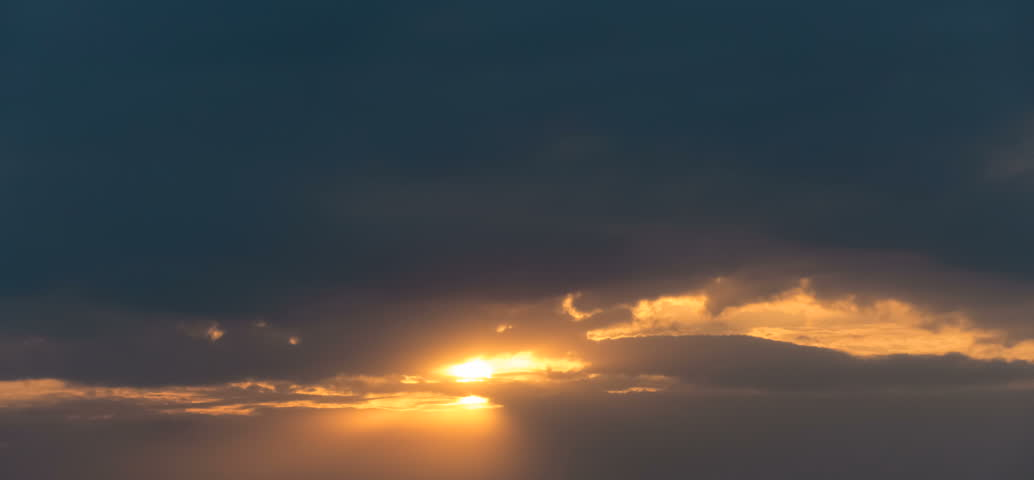 Sunset in rainy clouds. Time lapse.