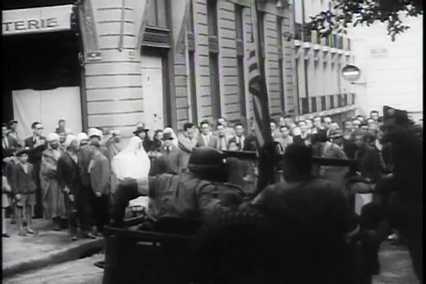 Ronald Reagan narrates footage of General Patton being greeted by enthusiastic crowds and soldiers in North Africa during WWII. (TheB)