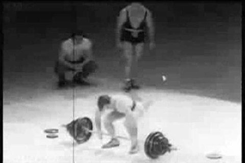 Spectators applaud weightlifters Pete George and John Davis at an Olympics Madison Square Garden benefit in 1951. (1950s)