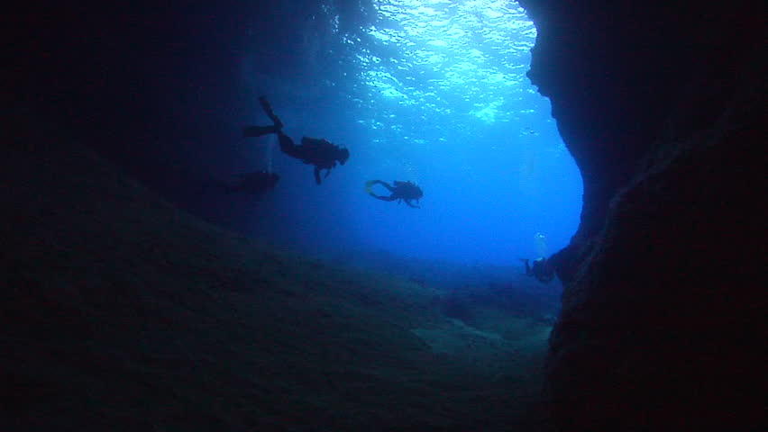 Group of scuba divers swimming in cavern in Kingdom of Tonga, HD, UP15317 | Shutterstock HD Video #19704802