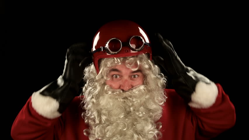 Santa Claus biker is wearing his red suit and preparing to ride his bike to deliver gifts  edit